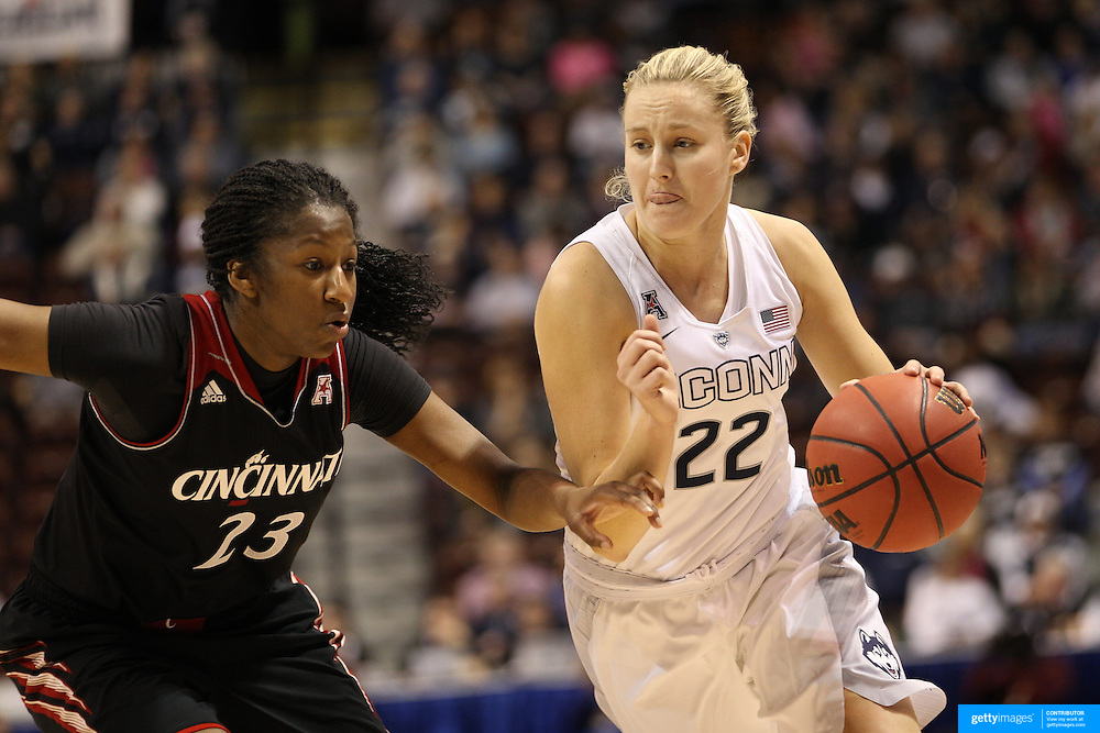Courtney Ekmark, UConn, drives past Jasmine Whitfield, Cincinnati, during the UConn Vs Cincinnati Quarterfinal Basketball game at the American Women's College Basketball Championships 2015 at Mohegan Sun Arena, Uncasville, Connecticut, USA. 7th March 2015. Photo Tim Clayton