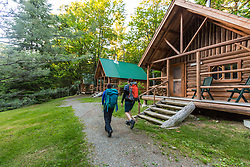 Two women return from a hike to the Appalachian Mountain Club's Little Lyford Lodge and Cabins in Maine's 100 Mile WIlderness.