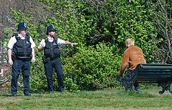 ©Licensed to London News Pictures 14/04/2020  <br /> Greenwich, UK. Police asking a man to move on. Sunny weather in Greenwich park, Greenwich, London as people get out of the house from coronavirus lockdown to exercise. Photo credit:Grant Falvey/LNP