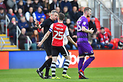 Jake Taylor (25) of Exeter City confronts referee Christopher Sarginson after what Exeter City though was the equalising goal was ruled out after the assistant was consulted during the EFL Sky Bet League 2 match between Exeter City and Grimsby Town FC at St James' Park, Exeter, England on 29 December 2018.