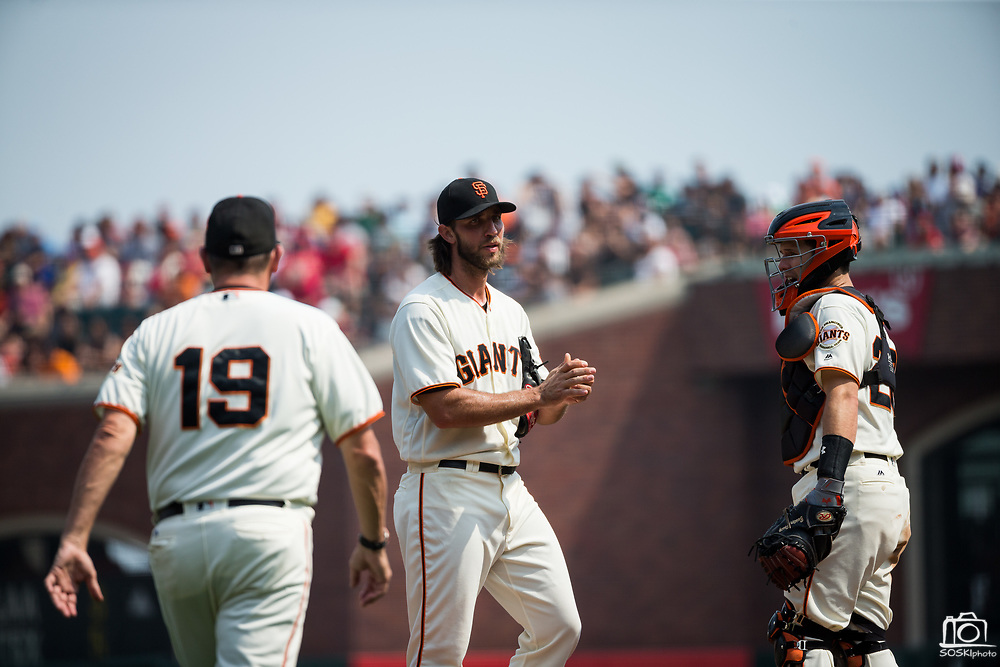 San Francisco Giants starting pitcher Madison Bumgarner (40) waits for San Francisco Giants pitching coach Dave Righetti (19) to talk to him on the mound during a MLB game against the St. Louis Cardinals at AT&T Park in San Francisco, California, on September 3, 2017. (Stan Olszewski/Special to S.F. Examiner)