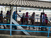 07 OCTOBER 2014 - GEORGE TOWN, PENANG, MALAYSIA: People arrive in George Town on Penang Island from Butterworth on the Malaysian mainland. George Town (also Georgetown) is the capital of the state of Penang in Malaysia. Named after Britain's King George III, George Town is located on the north-east corner of Penang Island. The inner city has a population of 720,202 and the metropolitan area known as George Town Conurbation which consists of Penang Island, Seberang Prai, Kulim and Sungai Petani has a combined population of 2,292,394, making it the second largest metropolitan area in Malaysia. The inner city of George Town is a UNESCO World Heritage Site and one of the most popular international tourist destinations in Malaysia.         PHOTO BY JACK KURTZ