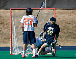 Navy defenseman Jaren Woeppel (45) celebrates after scoring against UVA.  The Virginia Cavaliers scrimmaged the Navy Midshipmen in lacrosse at the University Hall Turf Field  in Charlottesville, VA on February 2, 2008.