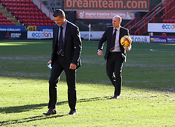 Referee Iain Williamson and Fourth Official Andy Davies check the state of the pitch prior to calling the match off - Photo mandatory by-line: Robin White/JMP - Tel: Mobile: 07966 386802 11/01/2014 - SPORT - FOOTBALL - The Valley - Charlton - Charlton Athletic v Barnsley - Sky Bet Championship