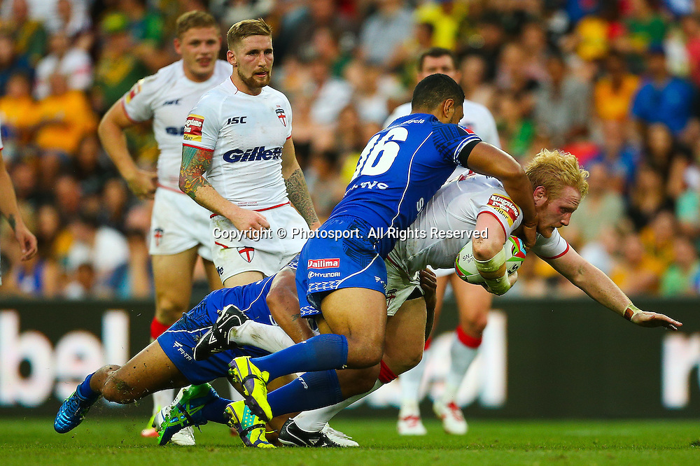 James Graham is tackled by Isaac Liu (R) during the Four Nations test match between England and Samoa at Suncorp Stadium,  Brisbane Australia on October 18, 2014.