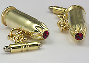 SPOILER ALERT: Dame Judi Dench creates stylish 007 souvenir by turning brass bullets from final Skyfall scene in to cufflinks<br /> 