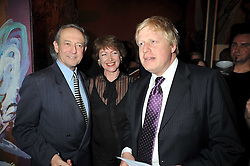 Left to right, DAN TOPOLSKI, his wife SUSAN GILMOUR and  BORIS JOHNSON at a party to celebrate the opening of Topolski Century held at The Arches, Hungerford Bridge, London SE1 on 16th March 2009.