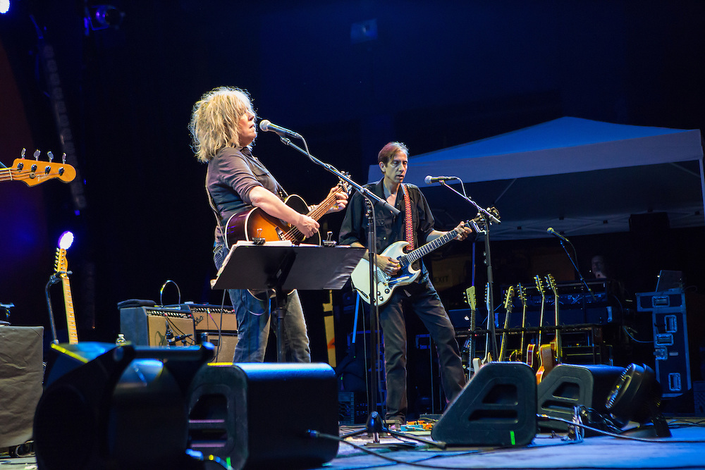 Lucinda Williams, and guitarist Stuart Mathis on stage at Celebrate Brooklyn.