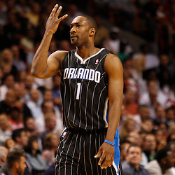 March 3, 2011; Miami, FL, USA; Orlando Magic point guard Gilbert Arenas (1) celebrates after scoring during the fourth quarter against the Miami Heat at the American Airlines Arena. The Magic defeated the Heat 99-96.    Mandatory Credit: Derick E. Hingle