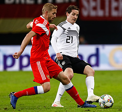 November 16, 2018 - Leipzig, Germany - Sebastian Rudy (R) of Germany and Yury Gazinsky of Russia vie for the ball during the international friendly match between Germany and Russia on November 15, 2018 at Red Bull Arena in Leipzig, Germany. (Credit Image: © Mike Kireev/NurPhoto via ZUMA Press)
