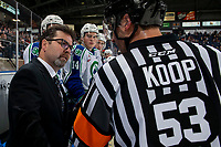 KELOWNA, BC - OCTOBER 16:  Swift Current Broncos head coach, Dean Brockman, speaks to referee Corey Koop from the bench against the Kelowna Rockets at Prospera Place on October 16, 2019 in Kelowna, Canada. (Photo by Marissa Baecker/Shoot the Breeze)