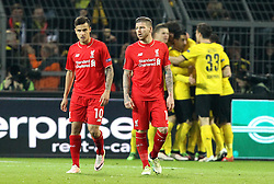 Philippe Coutinho and Alberto Moreno of Liverpool look frustrated as Borussia Dortmund celebrate Mats Hummels' goal - Mandatory by-line: Robbie Stephenson/JMP - 07/04/2016 - FOOTBALL - Signal Iduna Park - Dortmund,  - Borussia Dortmund v Liverpool - UEFA Europa League Quarter Finals First Leg