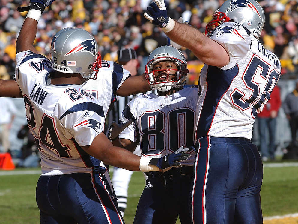 (01/27/02 Pittsburgh, PA) AFC Championship Game, Patriots vs Pittsburgh. Troy Brown  Dances in a circle with Ty Law and Matt Chatham after Browns Punt return for a TD. (012702patsmjs - Staff Photo by Michael Seamans)