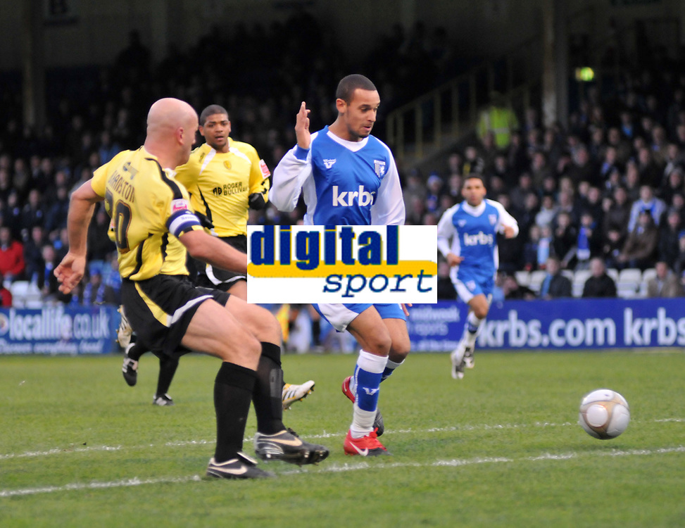 Photo: Tony Oudot/Richard Lane Photography. Gillingham v Burton Albion. FA Cup 2nd Round. 28/11/2009. <br /> Gillingham goalscorer Curtis Weston goes close watched by Guy Branston of Burton