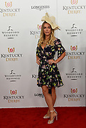 Teddi Mellencamp, daughter of singer John Mellencamp, walks the Kentucky Derby red carpet, Saturday, May 5, 2018, at Churchill Downs in Louisville, Ky.  Longines, the Swiss watch manufacturer known for its luxury timepieces, is the Official Watch and Timekeeper of the 144th annual Kentucky Derby. (Photo by Diane Bondareff/Invision for Longines/AP Images)