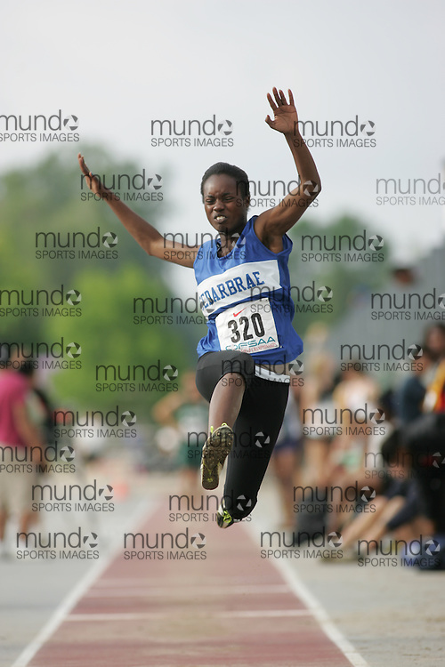 (London, Ontario}---03 June 2010) Rehanna Thompson of Cedarbrae  - Scarborough competing in the senior girls long jump at the 2010 OFSAA Ontario High School Track and Field Championships. Photograph copyright Sean Burges / Mundo Sport Images, 2010.