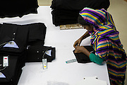 A garment worker folding clothes inside an Epyllion Group garment factory in Bangladesh.