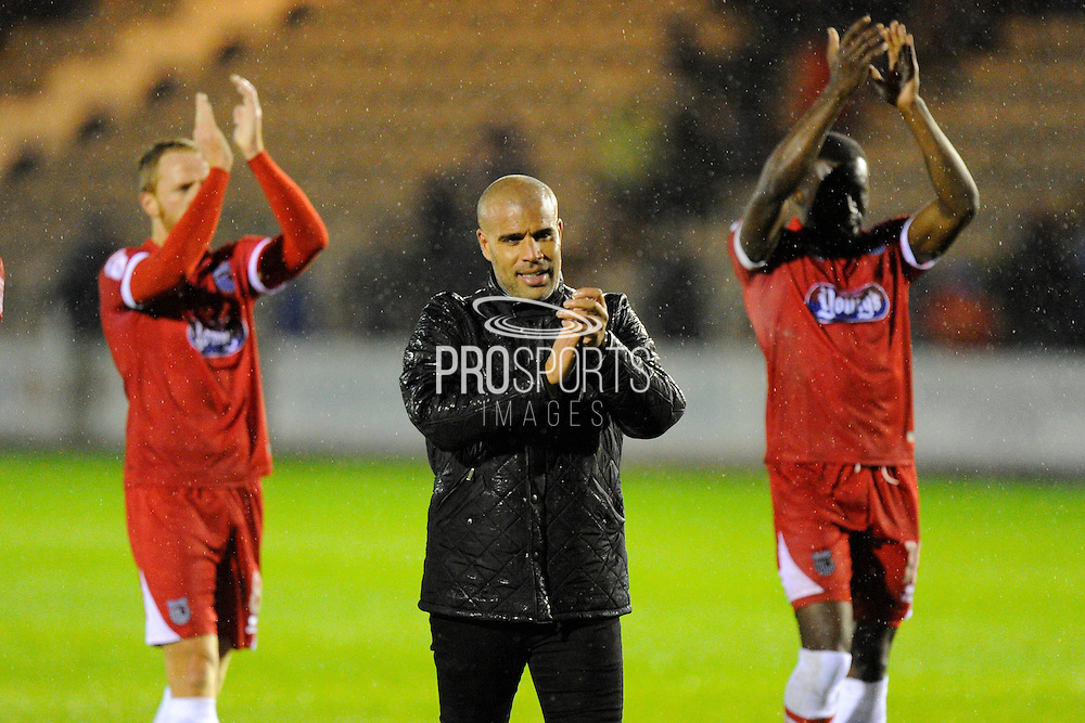 Grimsby Town manager Marcus Bignot celebrates the 3-0 win over Plymouth at full time with his team in front of the travelling fans during the EFL Sky Bet League 2 match between Plymouth Argyle and Grimsby Town FC at Home Park, Plymouth, England on 19 November 2016. Photo by Graham Hunt.