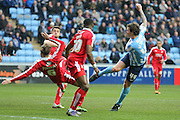 Coventry City forward Darius Henderson (44)  sees his last minute shot saved during the Sky Bet League 1 match between Coventry City and Swindon Town at the Ricoh Arena, Coventry, England on 19 March 2016. Photo by Simon Davies.