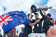 The Great Sound, Bermuda, 26th June 2017. Emirates Team New Zealand CEO Grant Dalton with Helmsman Peter Burling and skipper Glenn Ashby  as they hold aloft the America's Cup.