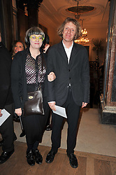 GRAYSON PERRY and his wife PHILLIPPA PERRY at a private view of the Royal Academy's Modern British Sculpture exhibition held at Burlington House, Piccadilly, London on 18th January 2011.