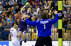 Luka Zvizej of Slovenia vs Hugo Figueira of Portugal during handball match between National teams of Slovenia and Portugal in the Qualifications of the EHF EURO 2012, on October 27, 2010 at Arena Zlatorog, Celje, Slovenia. (Photo By Vid Ponikvar / Sportida.com)