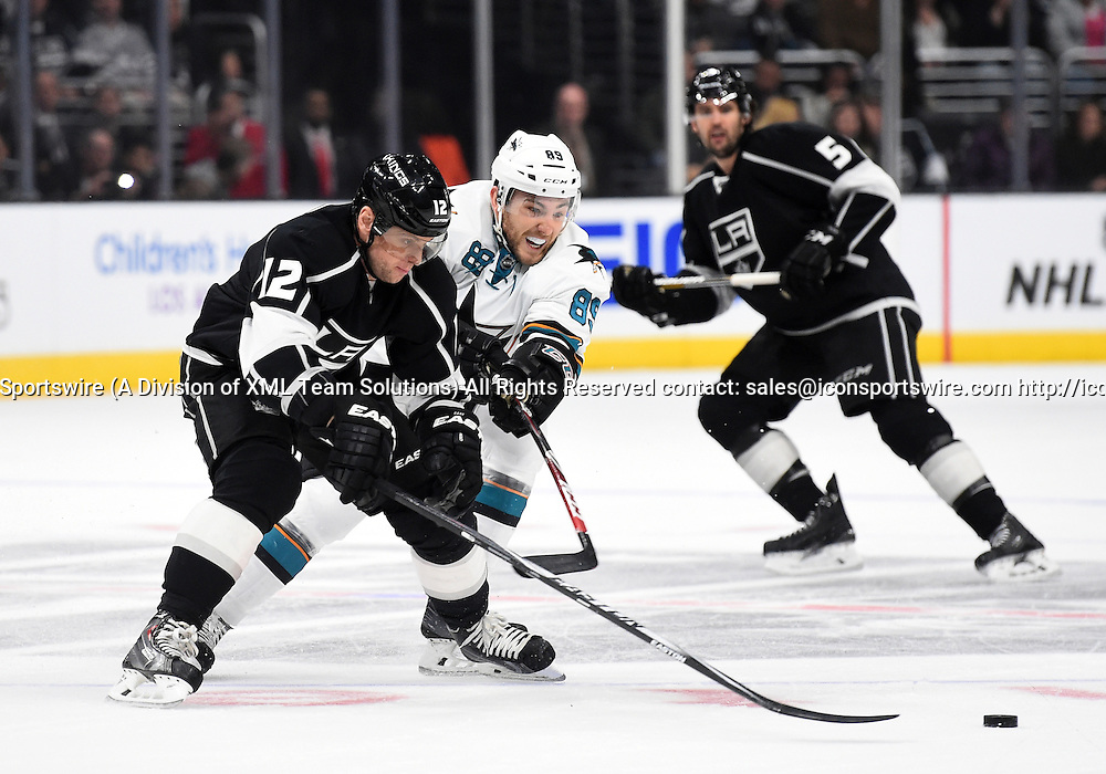 27 December 2014: San Jose Sharks Left Wing Barclay Goodrow (89) [9171] tries to steal the puck from Los Angeles Kings Left Wing Marian Gaborik (12) [2096] during an NHL game between the San Jose Sharks and the Los Angeles Kings at STAPLES Center in Los Angeles, CA.