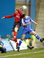 Photo: Olly Greenwood.<br />Gillingham v Swansea City. Coca Cola League 1. 25/03/2006. Swansea's Alan Tate (L) and Gillingham's Tommy Black.