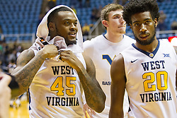 Nov 11, 2016; Morgantown, WV, USA; West Virginia Mountaineers forward Elijah Macon (45) and West Virginia Mountaineers forward Brandon Watkins (20) celebrate after beating Mount St. Mary's Mountaineers at WVU Coliseum. Mandatory Credit: Ben Queen-USA TODAY Sports