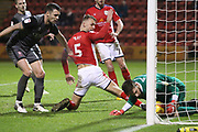 #1 Josh Vickers saves a close shot for Lincoln from an attempt from 5 George Ray for Crewe Alexander during the EFL Sky Bet League 2 match between Crewe Alexandra and Lincoln City at Alexandra Stadium, Crewe, England on 26 December 2018.
