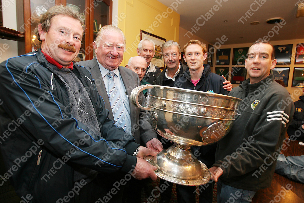 James Moynihan,John Lovett,Pat Cronin,John McCarthy and Eamon O'Connor with Colm Cooper ,Pat O'Shea and the Sam Maguire at Newmarket GAA Club on Tuesday night.<br /><br />Photograph by Eamon Ward