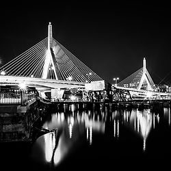 Boston black and white photo of the Zakim Bunker Hill Bridge at night. The Leonard P. Zakim Bunker Hill Memorial Bridge is a cable bridge that spans the Charles River in Boston, Massachusetts in the Eastern United States of America. Copyright ⓒ Paul Velgos with All Rights Reserved.
