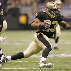 Jan 24, 2010; New Orleans, LA, USA; New Orleans Saints running back Pierre Thomas runs away from Minnesota Vikings safety Madieu Williams (20) during the second quarter of the 2010 NFC Championship game at the Louisiana Superdome. Mandatory Credit: Derick E. Hingle-US PRESSWIRE