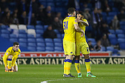 Leeds United defender, Lewie Coyle (31) and Leeds United midfielder, Liam Bridcutt during the Sky Bet Championship match between Brighton and Hove Albion and Leeds United at the American Express Community Stadium, Brighton and Hove, England on 29 February 2016. Photo by Phil Duncan.