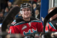 KELOWNA, CANADA - DECEMBER 6: Carter Rigby #11 of the Kelowna Rockets stands at the bench against the Everett Silvertips on December 6, 2013 at Prospera Place in Kelowna, British Columbia, Canada.   (Photo by Marissa Baecker/Shoot the Breeze)  ***  Local Caption  ***