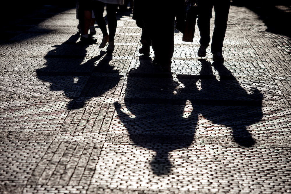 Shadows on the cobblestone pavement of Old Town Square in the center of Prague.