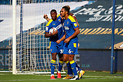 AFC Wimbledon striker Joe Pigott (39) GOAL 1-1 with team mates during the EFL Sky Bet League 1 match between AFC Wimbledon and Plymouth Argyle at the Kiyan Prince Foundation Stadium, London, England on 19 September 2020.