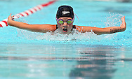Lion Swim Club's Hayley Kimmel, 8, leads the pack in the butterfly section of the Girls 8 & Under 100 Yard Individual Medley at the All City Swim Meet at Cherry Hill Aquatic Center in Cedar Rapids on Saturday, July 20, 2013. 623 athletes from ages 4-17 participated in the meet.
