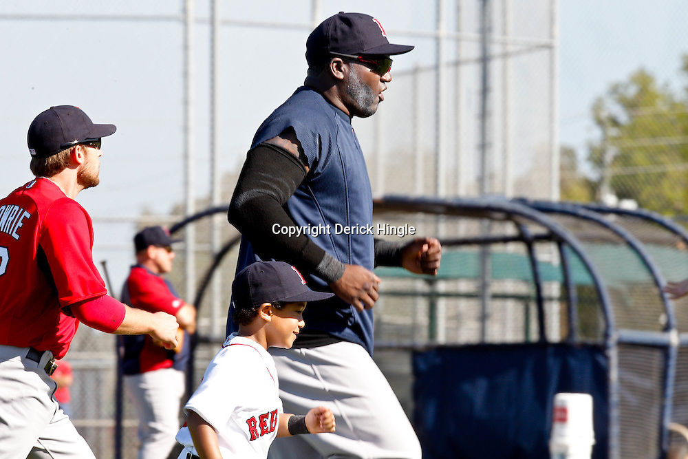 February 19, 2011; Fort Myers, FL, USA; Boston Red Sox first baseman David Ortiz (34) and son D'Angelo Ortiz run during spring training practice at the Player Development Complex.  Mandatory Credit: Derick E. Hingle