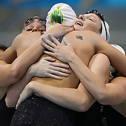 The Australian team of Alicia Coutts, Cate Campbell, Elmslie Brittany and Melanie Schlanger celebrate winning the gold medal in the women's 4 x 100m freestyle relay final during the swimming finals at the Aquatic Centre at Olympic Park, Stratford during the London 2012 Olympic games. London, UK. 28th July 2012. Photo Tim Clayton