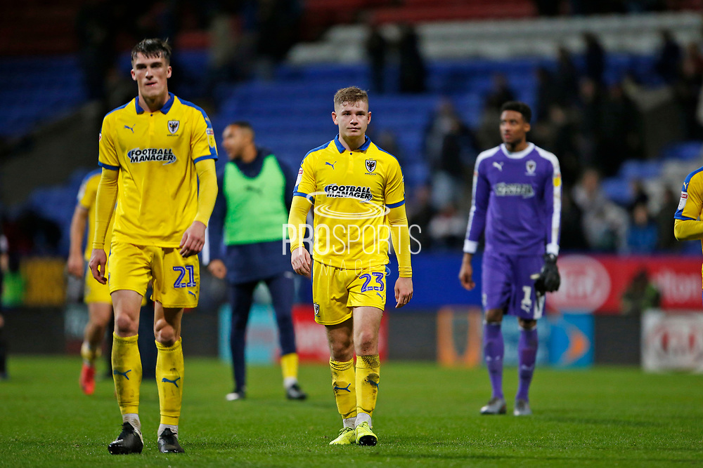 Disappointed  Ryan Delaney of Wimbledon  and Max Sanders of Wimbledon at full time during the EFL Sky Bet League 1 match between Bolton Wanderers and AFC Wimbledon at the University of  Bolton Stadium, Bolton, England on 7 December 2019.