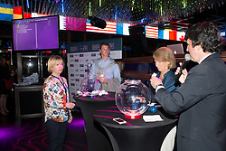 Beezie Madden, (USA) and Daniel Deusser, (GER) performing the draw in the Hakkasan Club at the MGM Hotel<br /> Reem Acra FEI World Cup™ Dressage Finals <br /> Las Vegas 2015<br />  © Hippo Foto - Dirk Caremans<br /> 16/04/15