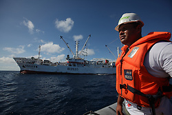 INDIAN OCEAN 26APR13 - Greenpeace volunteer Victor Pickering of Fiji observes the  Taiwanese longliner Yi Long No 202 during tuna transhipment on the high seas in the Indian Ocean.<br /> <br /> The Greenpeace ship Esperanza is on patrol in the Indian Ocean documenting fishing activities.<br /> <br /> <br /> <br /> jre/Photo by Jiri Rezac / Greenpeace