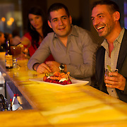 Advertising campaign for Xocolat Restaurant shot for William Joseph Communications. Woman checking out two men at a bar.<br />