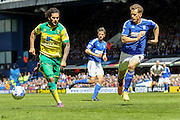Bradley Johnson looks to outwit Christophe Berra during the Sky Bet Championship Play Off First Leg match between Ipswich Town and Norwich City at Portman Road, Ipswich, England on 9 May 2015. Photo by Simon Davies.
