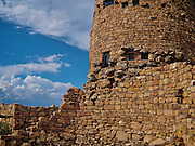 Closeup view of Watchtower at Desertview with a section of another building used to store firewood.