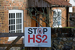 © Licensed to London News Pictures. 27/01/2012. Little Missenden, UK. An anti HS2 (High Speed Rail 2) sign outside a property in the village of Little Missenden, Buckinghamshire. Scheduled to be completed by 2033, the new Rail system will have huge effects on the English town. Photo credit : Ben Cawthra/LNP