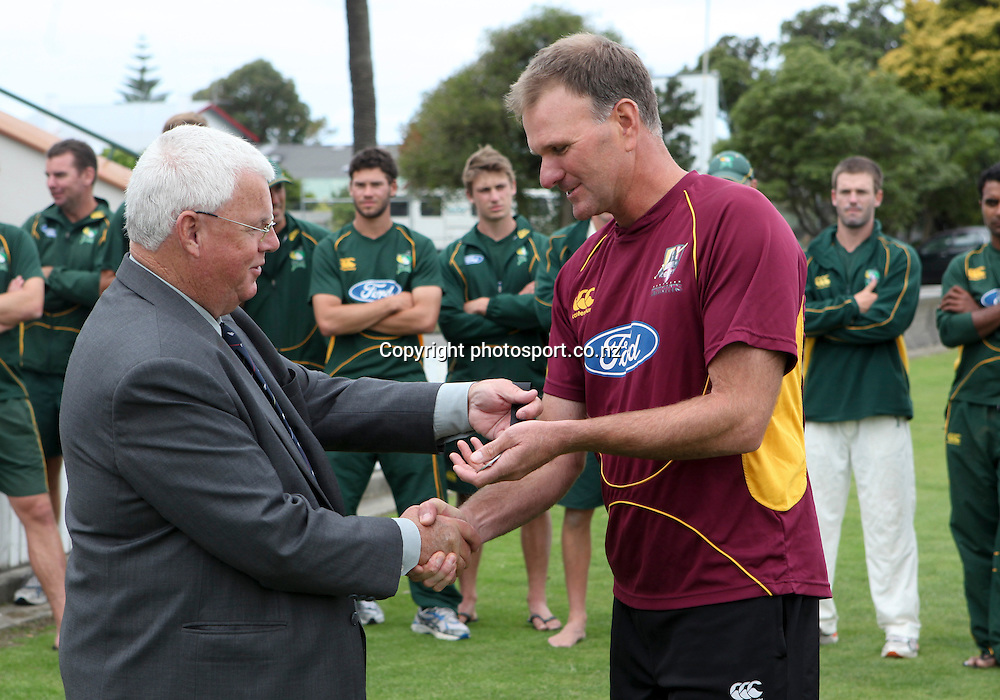 Northerns Districts Knights coach, Grant Bradburn is presented with his winners medal for the Plunket Shield by Denis Currie, President of NZC, after winning the series , Nelson Park, Napier, New Zealand. Thursday 29 March, 2012. Photo: John Cowpland / photosport.co.nz