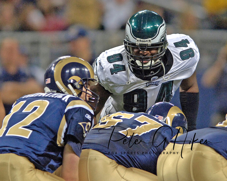 Philadelphia Eagles defensive end N.D. Kalu (94) stares in at St. Louis Rams quarterback Ryan Fitzpatrick (12) before the snap of the ball, at the Edward Jones Dome in St. Louis, Missouri, December 18, 2005.  The Eagles beat the Rams 17-16.