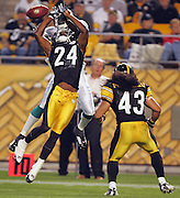 PITTSBURGH - SEPTEMBER 7:  Cornerback Ike Taylor #24 goes airborne to defend a pass while safety Troy Polamalu #43 of the Pittsburgh Steelers lends cover support as wide receiver Chris Chambers #84 of the Miami Dolphins leaps high for an incomplete pass at Heinz Field on September 7, 2006 in Pittsburgh, Pennsylvania. The Steelers defeated the Dolphins 28-17. ©Paul Anthony Spinelli *** Local Caption *** Ike Taylor;Troy Polamalu;Chris Chambers